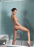 Hairy brunette Silvie showering