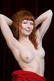 Redhead Rochelle shows off her bush